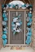 Christmas Door Decoration Tips.Think silver and frosty whites for your front door decor. This would be a great look to keep up all winter.