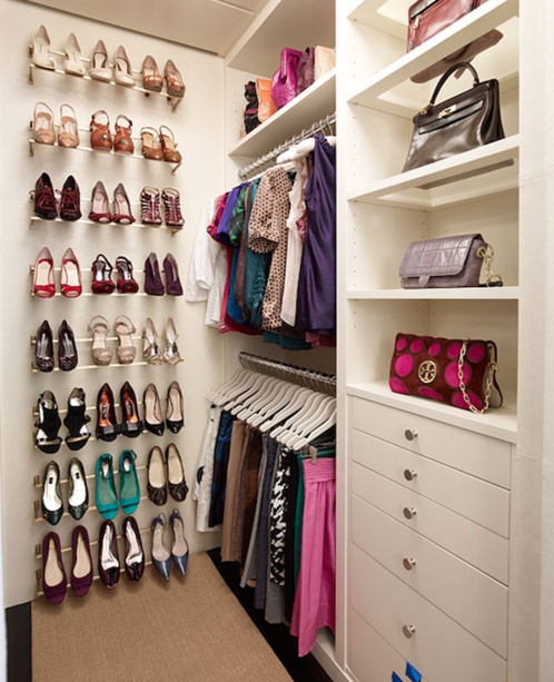 Shoe shelves, pull-out clothing rails for ease of access. I would need at least two other compartments for hanging clothes and probably more shelves...