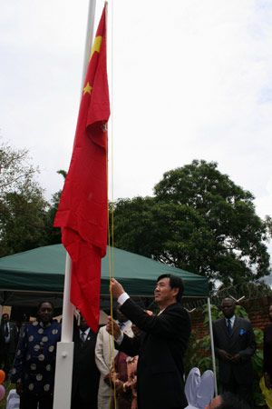 The representative of Chinese President Hu Jintao and assistant foreign minister Zhai Jun raises the Chinese flag at the opening ceremony of the Embassy of the People's Republic of China in Lilongwe, capital of Malawi, Jan. 26, 2008. Chinese Foreign Minister Yang Jiechi and Malawian Minister for Presidential and Parliamentary Affairs Davis Katsonga signed a joint communique in Beijing on Dec. 28, 2007 to forge diplomatic relations.