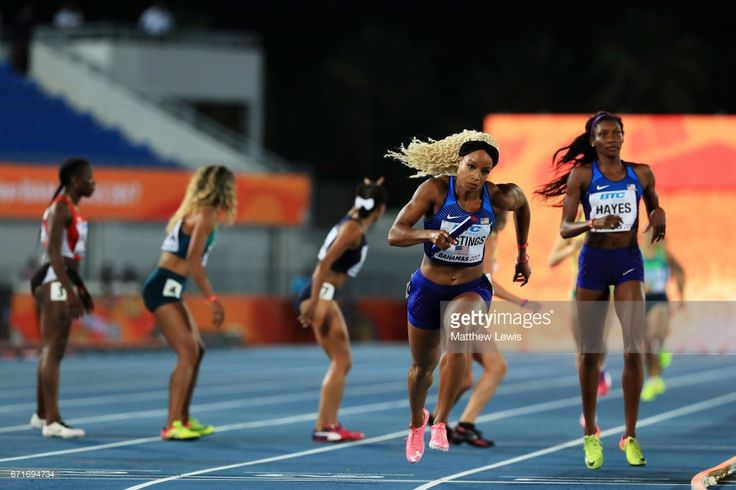 Quanera Hayes hands off to Natasha Hastings of team USA in heat one of the Women's 4 x 400 Meters Relay during the IAAF/BTC World Relays Bahamas 2017 at Thomas Robinson Stadium on April 22, 2017 in Nassau, Bahamas.