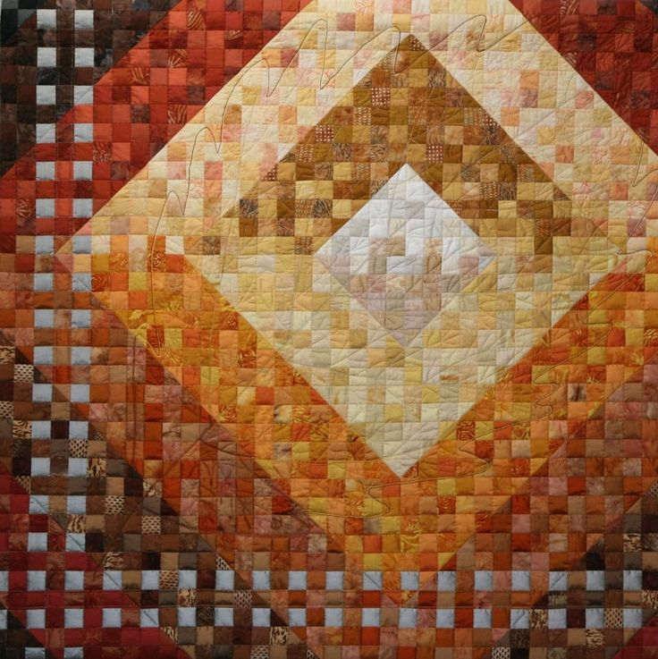 I like all the squares. and the colors, and the shading. and the cool border on the left and bottom. but I don't quite get the giant leaf quilted on it.