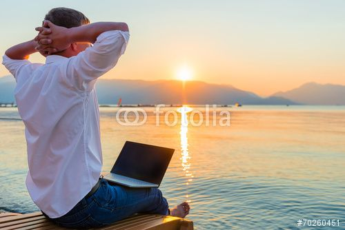 Recreational entrepreneur. Man with laptop in the morning on the