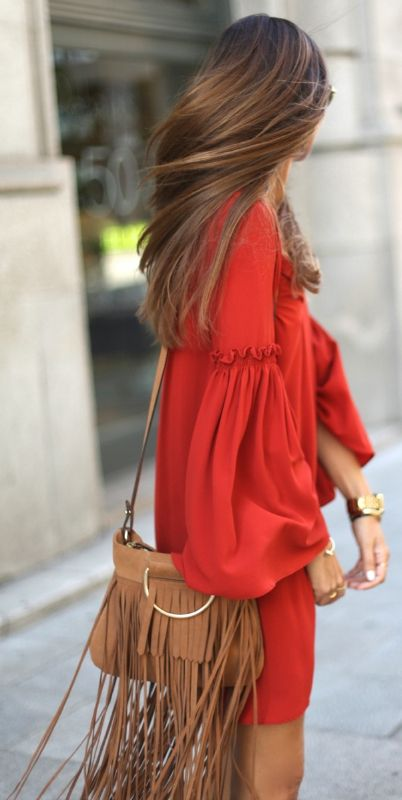 Red is always a good colour to make an impression - and it's even better when it's a cute bell sleeved dress paired with a fringed bag. Via Silvia Garcia   Dress: Zara, Bag: Mango