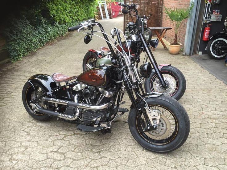 A pair of sick Harley's including springer front ends, shotgun exhaust, and ape hanger bars.