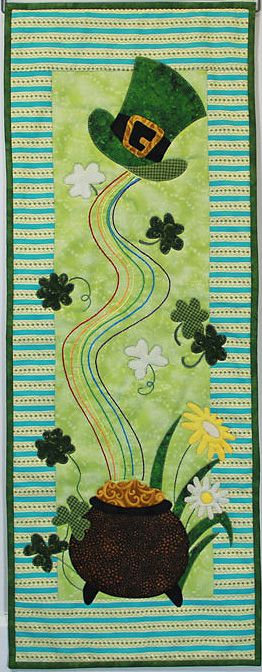"Lucky's Pot 'O Gold small quilted wall hanging pattern. Finishes at 12"" x 32"".  Click here:  http://www.patchabilities.com/shop/Patterns/Monthly-Minis-7-Series/p/MM703-Luckys-PotO-Gold-x6521926.htm Uses fusible applique method. Pattern includes simple, instructions with complete binding and embroidery stitching directions. Beginner friendly."