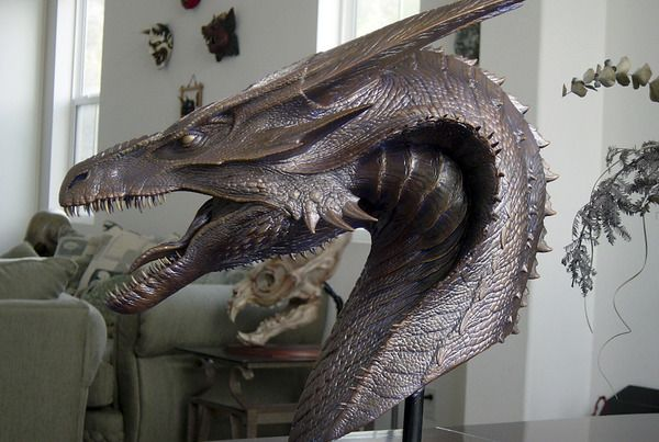 A beautifully rendered bust of a dragon from REIGN OF FIRE that Steve Wang created in collaboration with Miles Teves.