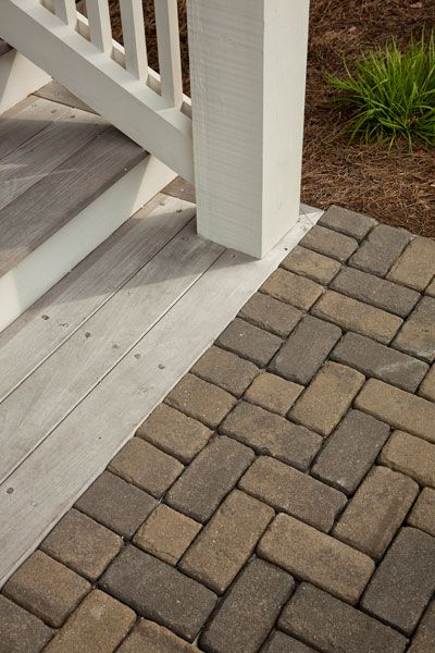detail: transition from pavers to wooden porch steps and railing. Geoff Chick, Architect