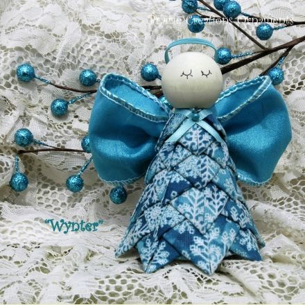Kit and Pattern for a quilted no sew angel ornament.  This beautiful turquoise with snowflakes angel will be a beautiful addition to your Christmas décor. $19.95