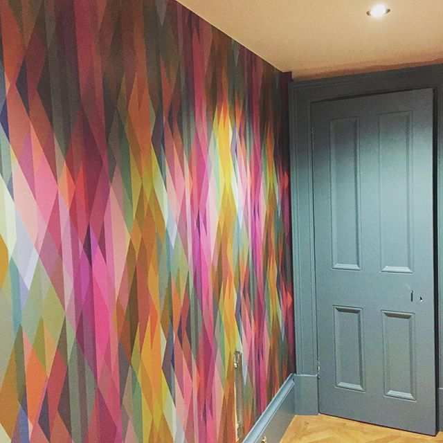 Our basement hallway now looks like THIS! It's like going down the rabbit hole, Alice in Wonderland style. Completely smitten by this Cole & Son Prism wallpaper - the pinks and purples are particularly perfect - and it goes brilliantly with Farrow & Ball Stone Blue (props @jessicabuckleyinteriors ) well as the bright green Arsenic (out of shot). Ccomplete tour coming soon www.pinkhouse.co.uk..