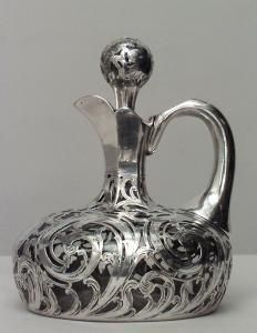 American Victorian decanter with silver deposit scroll design with handle and (inside spout & stopper as is)