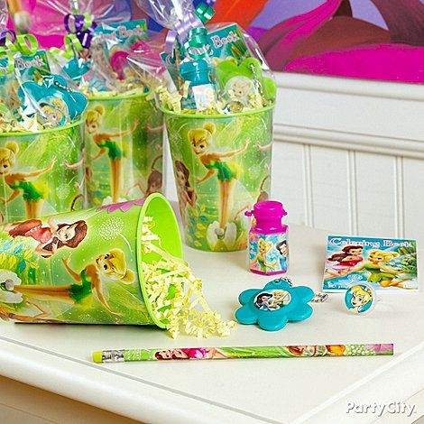 Send friends home with a reusable cup filled with Tinker Bell favors like mirror key chains, slipped inside a clear favor bag and tied with pretty ribbon. Click for more TinkerBell party ideas!