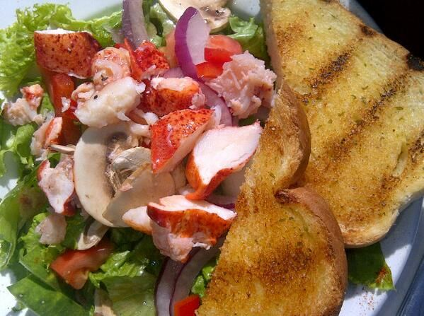 Salad topped w fresh PEI lobster at Blue Mussel Cafe in PEI. Photo by @EatDrinkTravelMag