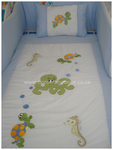 Under the sea bale set includes:    100% cotton fabric and easy breathe cot bumper inner.    Quilt  Cot bumper  Mini scatter cushion  Fitted sheet (to fit large cot)