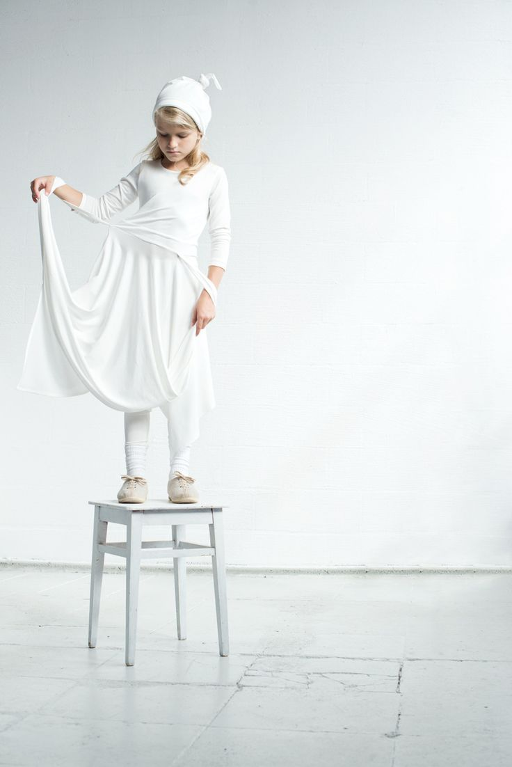 Katrina Tang Photography for Xenia Joost design SS 15. Studio shoot with a girl dressed in white, standing on a chair #katrinatang #tangkatrina