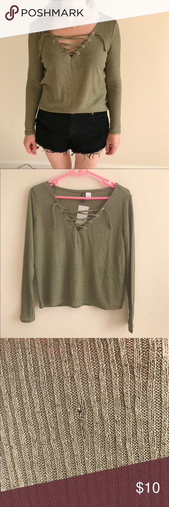 Olive green lace up shirt Cute olive green lace up shirt! There is a minor hole in the back but it is barely noticeable! 😊 H&M Tops