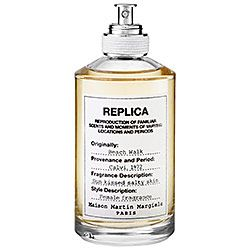 MAISON MARTIN MARGIELA - 'REPLICA' Beach Walk Beach Walk combines fresh and radiant notes of bergamot, coconut milk, lemon, pink pepper, and musk to evoke a familiar but forgotten moment—a walk along a sandy beach.