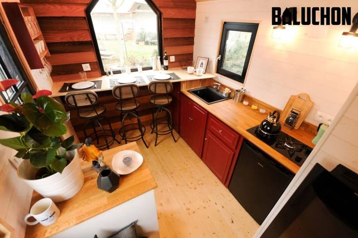 French tiny house is kid-friendly. The kitchen has a 2-burner stove. The bathroom includes a composting toilet and shower/bath, but no sink as there wasn't deemed enough room – the family will have to avail themselves of the kitchen sink. The ground floor kids room has its own door for privacy, which is an obvious benefit over having the kid sleep in a loft directly opposite (and in full view of) his or her parents, as is the case with most tiny houses. Calypso by Baluchon.