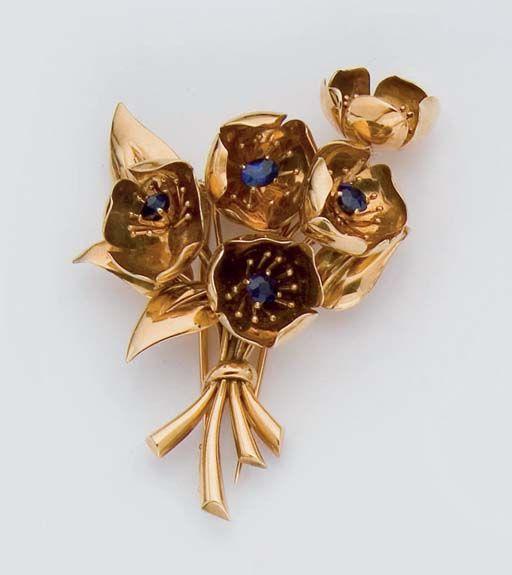 "A SAPPHIRE AND GOLD ""GERBE DE FLEURS"" CLIP BROOCH, BY VAN CLEEF & ARPELS, circa 1944"