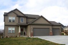 mastic-rugged-canyon-dark-brown-siding-and-staggered-shake-montana-suede-dark-brown-trim-certainteed-weathered-wood-roofing-in-downs-il