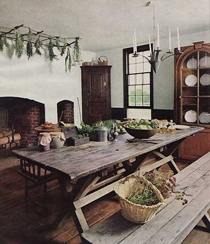 picnic table kitchen island vintage welcoming french country style rustic farmhouse large fireplace built cabinet simple crockery type bench sty