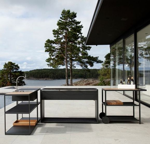 A modern outdoor kitchen & charcoal grill by Swedish designers Johan Ridderstrale & Mat Broberg for Roshults.First seen here: http://remodelista.com/posts/the-worlds-most-elegant-outdoor-grill.Roshults website: http://roshults.se/