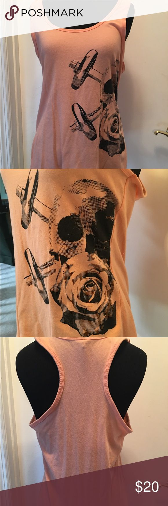 FITNESS COMPANY WORKOUT TANK FITNESS COMPANY WORKOUT TANK. Peach colored cotton tank. Skull with roses and barbells. Worn once. Size large. Feel free to make an offer. No trades please. Happy poshing!!❤️ Tops Tank Tops