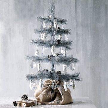 Antique Christmas Tree:   Silver glitter trees sparkle on tabletop or floor. Polished aluminum on wire. Check it out on West elm.