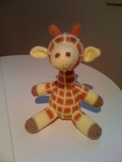 Knitted giraffe.  Finished in July.  Gone to my French teacher