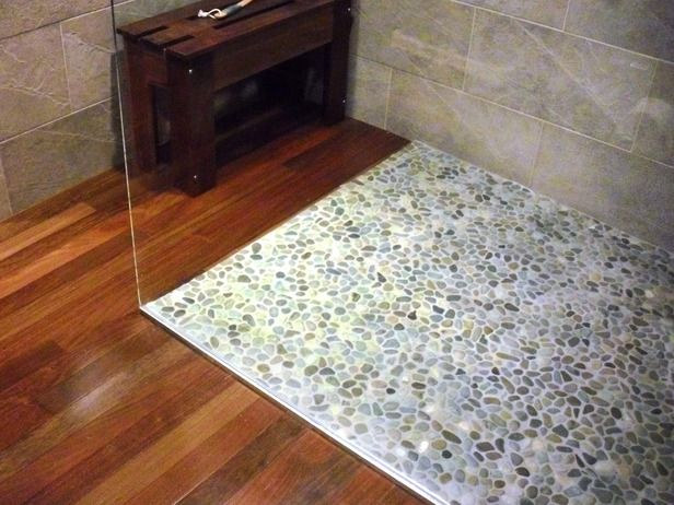 Saw something similar to this on an episode of income property, but they used the pebble mats instead of loose pebbles and they also did a pebble insert in the middle of the wood floor. Looked really good!