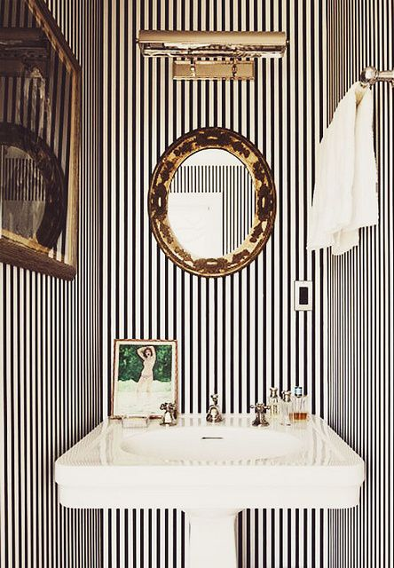 Tuxedo stripes look extremely chic in this powder room. Find more #bathroom inspiration via @BainUltra.