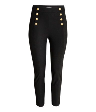 Black. Pants in stretch twill with decorative metal buttons at top. Concealed side zip, welt back pockets, and tapered legs.