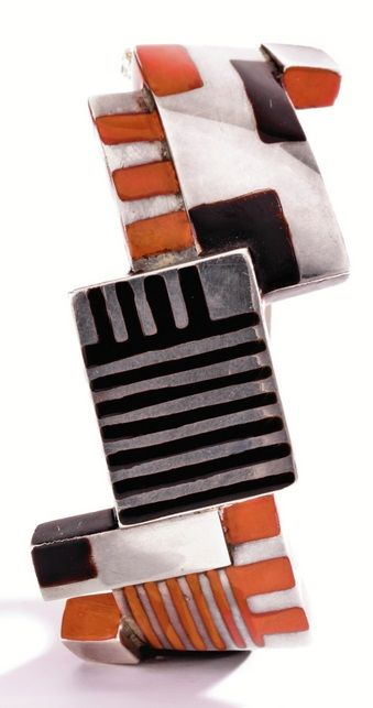 An Art Deco Silver and Lacquer Bangle-Bracelet, Jean Dunand, Circa 1924. The front composed of square and rectangular plaques applied with black and coral lacquer.