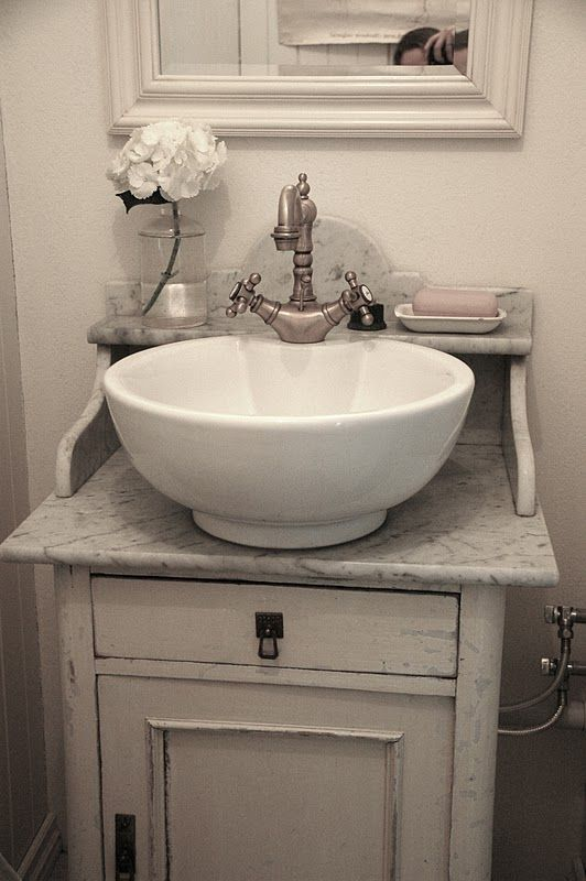 vintage shabby sink - perfect for a half-bath. Love the little shelf behind  the sink.