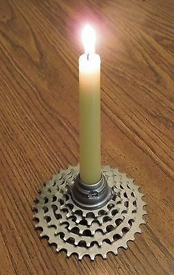 "This candle holder is made out of recycled bike parts. It is a great industrial-look style. It holds standard 7/8"" size candles. The gear base is roughly 4 1/2"" wide. The hub is 2"" diameter by 1 1/8"""