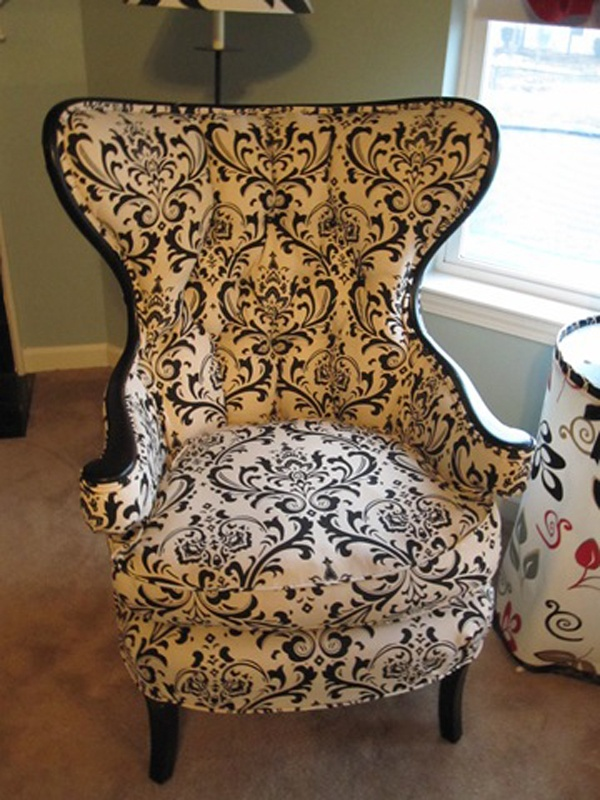 Love the design on this chair.  Is is strange that I would want the frame in a bullet proof material and the back upholstered with a lace up corset detail?