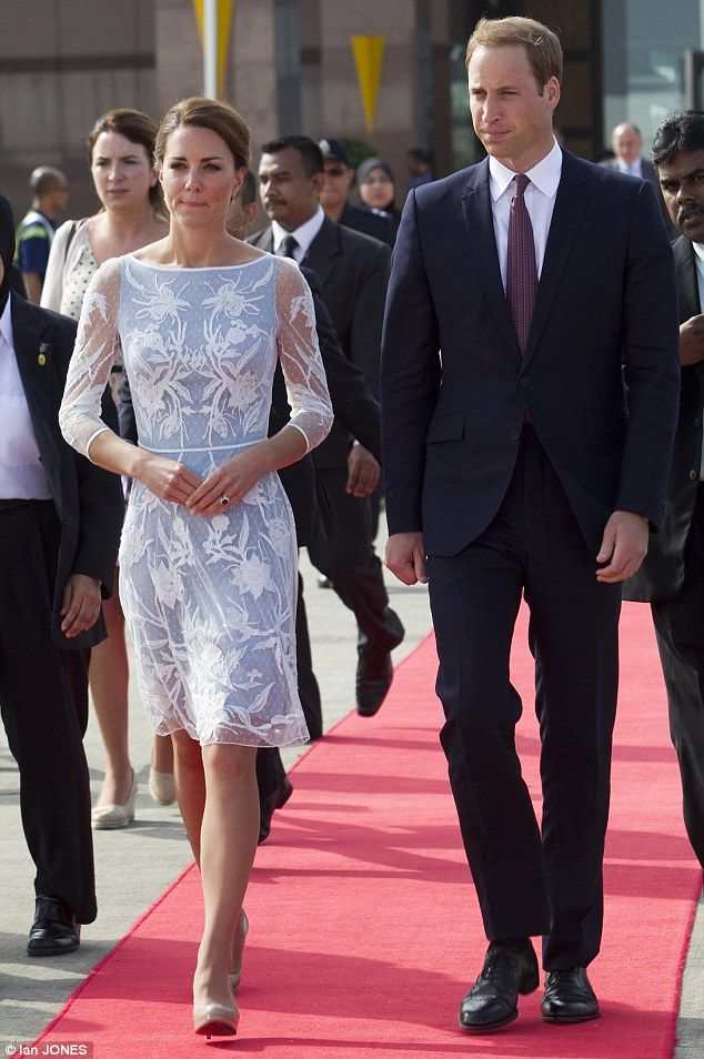 The Royal pair head down the red carpet towards a waiting Boeing 737-800 jet at Kuala lumpur's airport