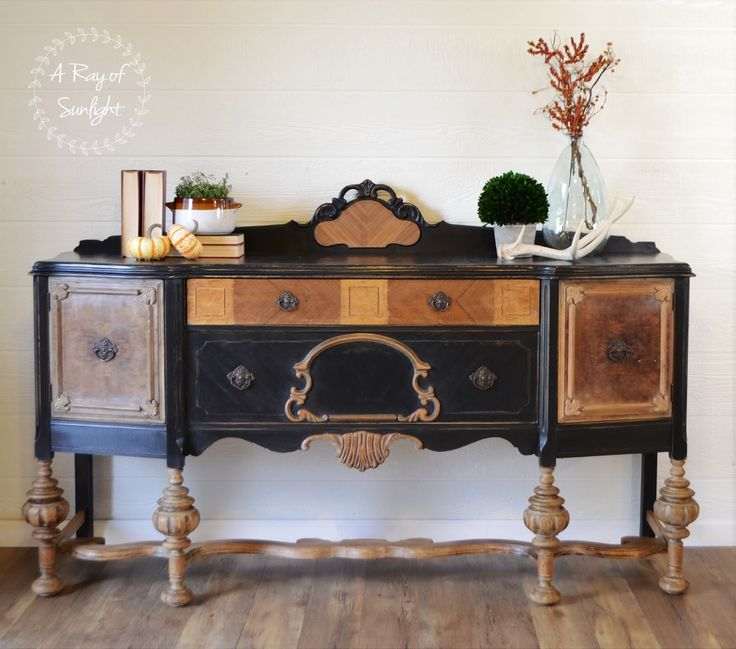 How to refinish an old worn out buffet with chipped veneer by repairing veneer with bondo, stripping wood with citristrip stripper, painting with chalk paint and wax. DIY refurbished furniture - black two-toned buffet