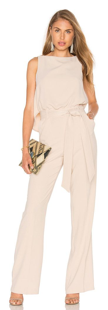 Epoch jumpsuit by Trina Turk. Poly blend. Dry clean only. Waist tie. Front slant pockets. Draped back detail. Hidden back zipper closure. Body meas...