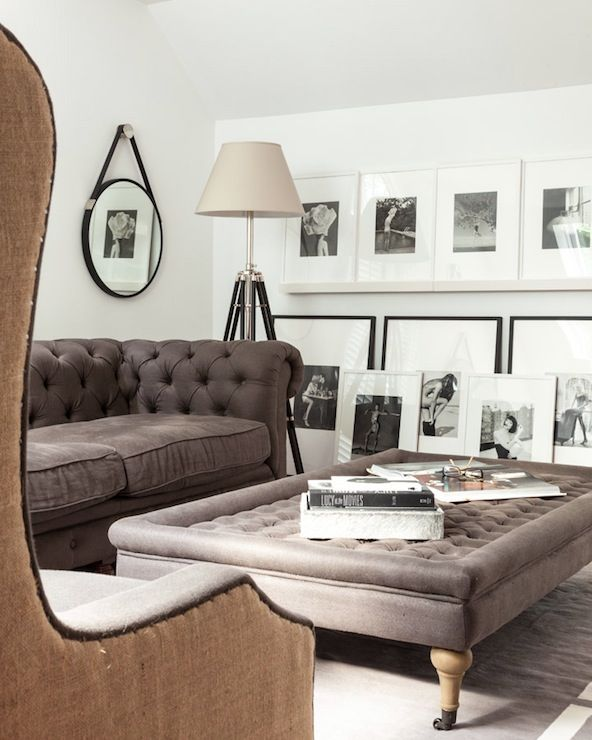 Adore Magazine - living rooms - gray chesterfield, black and white photo wall
