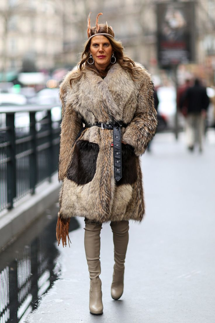Anna Dello Russo in feathers and fur. #Streetstyle at Paris Fashion Week #PFW