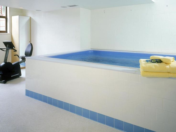 Endless pool photo gallery endless pool ideas for Basement swimming pool ideas