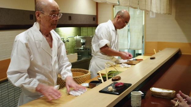 """A bite-sized view of Japanese culture, Jiro Dreams of Sushi, is nearly as meticulous as its subjects, Jiro Ono and his Tokyo restaurant. The movie's first word is oishi, Japanese for """"delicious,"""" and what follows is a treat for sushi veterans. First-timers, however, may wish for a little more context."""