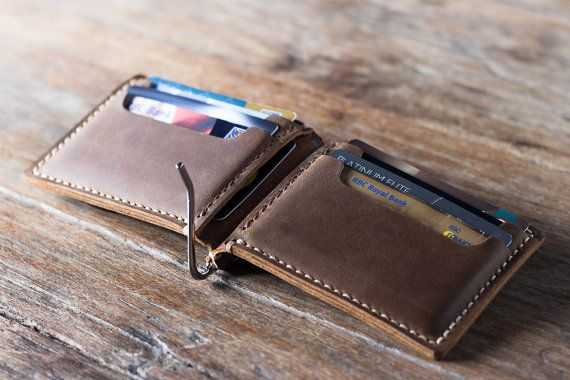 This leather money clip wallet is handmade and hand-stitched.  Inside there are 4 card slots which can hold 2 cards each for a total of 8 cards.