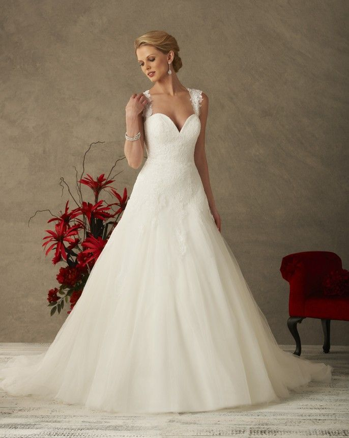 deedf033e89 6525 from our Love Collection by Bonny Bridal - A Line wedding gown with  layers of lace covered tulle. Open lace back finished…