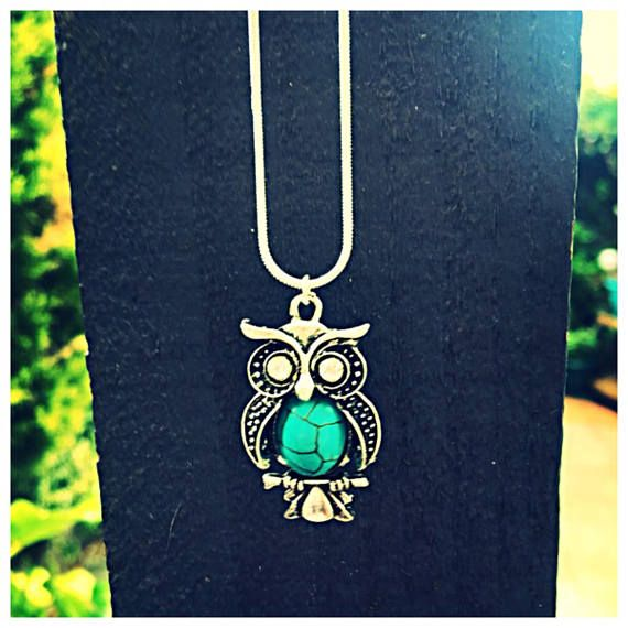 Molly McGhee Boutique  A lovely turquoise owl necklace with a 925 silver chain. An eye catching lovely item packaged in an organza gift bag. Wholesale orders available. Approximate Measurements:  Pendant Width: 20mm Length:35mm  Necklace Material: 925 Silver Length: 20