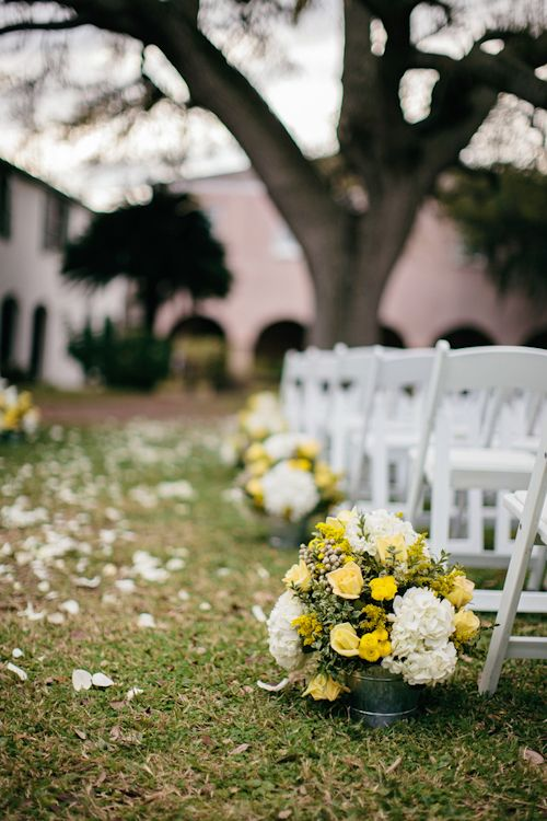 Beautiful Yellow And White Wedding Ceremony Arrangements Photo By Brooke Images Junebugweddings