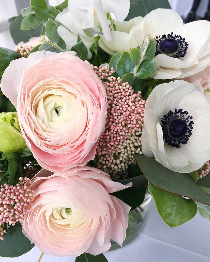 Such a pretty Spring arrangement. We love the ranunculus and anemones combo! The pale pink flowers pairs perfectly with the black and white anemones.