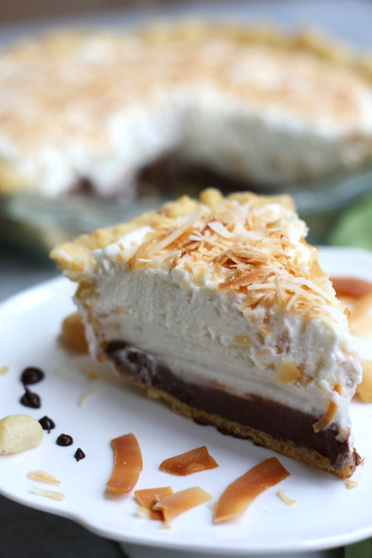 Haupia Pie With Macadamia Crust recipe is a cherished Hawaiian dessert. Flaky crust holds a coconut chocolate layer, coconut cream layer and finished off with a toasted coconut whipped cream. Without a doubt, the best pie I ever had.  http://www.thefedupfoodie.com