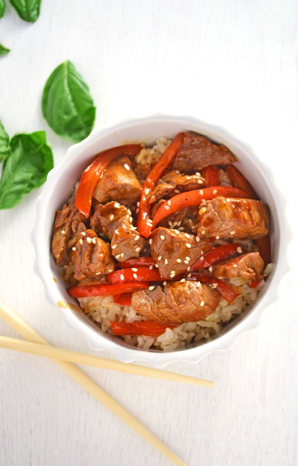 Spicy sriracha stir fry steak recipe sautéed in soy sauce, garlic, and sesame oil over rice.