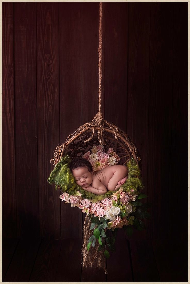 A sweet photography of baby girl in a flower basket.